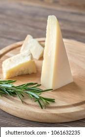 Grana Padano cheese on the wooden board