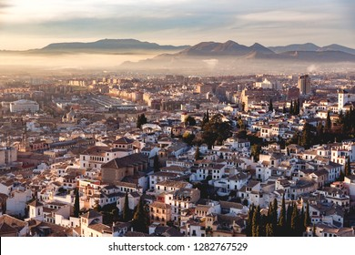 Granada, Andalucia / Spain - 23th of December, 2018: View of Granada, Andalusia, Spain at sunset, as seen from the Alhambra