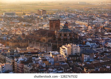 Granada, Andalucia / Spain - 23th of December, 2018: Cathedral of Granada in Andalusia, Spain, at sunset, as seen from the Alhambra