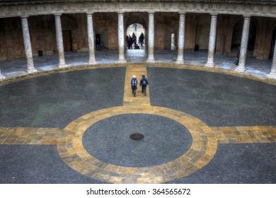 GRANADA, ANDALUCIA, SPAIN - Dec 11, 2012 - Colliseum-like courtyard of Palacio De Carlos V, at La Alhambra.