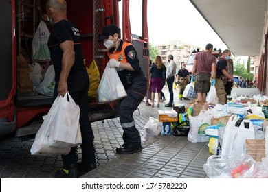 GRANADA, ANDALUSIA, SPAIN, MAY 31ST, 2020 Firefighters collecting food and basic necessities for victims of poverty from the Covid-19 pandemic.