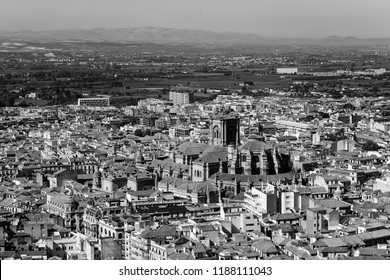 Granada cathedral viewed from Alcazaba in Alhambra palace, black and white photography