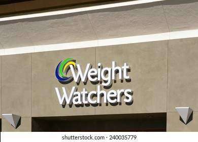GRANADA HILLS, CA/USA - DECEMBER 26, 2014: Weight Watchers International exterior and sign. Weight Watchers offers various products and services to assist weight loss and maintenance.