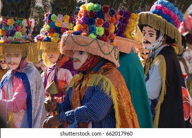 Granada, Nicaragua - February 15, 2017:  People wearing traditional dress and colorful masks during celebration of Carnival. Nicaragua traditional folk