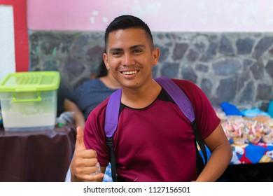 Granada, Nicaragua. February 7, 2018. A vendor selling deep fried yuca and cheese in Granada, Nicaragua