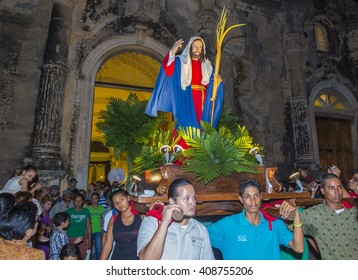 GRANADA , NICARAGUA - MARCH 20 : Unidentified Nicaraguan take part in the Palm sunday procession in Granada Nicaragua on March 20 2016. Palm sunday marks the beginning of the Holy week.
