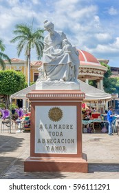 Granada, Nicaragua - November 20, 2016: A statue devoted to motherhood in Parque Central, Central Park in historic town of Granada in Nicaragua. The inscription reads Mother of all.