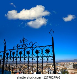 Granada skyline view from Albaicin in Andalusia Spain with iron fence