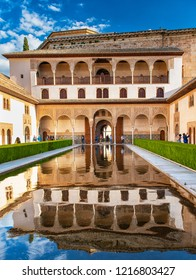 GRANADA, SPAIN - 14 MAY, 2018: The famous Alhambra in Granada, Spain on 14 May 2018. It is a palace and fortress complex located in Granada. It was originally constructed as a small fortress in 889.