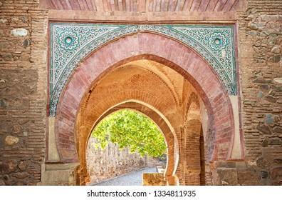 GRANADA, SPAIN - 14 MAY, 2018: Detail of the Alhambra Palace in Granada, Spain on 14 May 2018. It is a palace and fortress complex located in Granada
