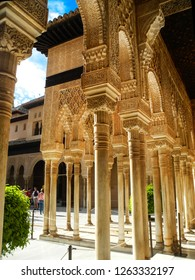 GRANADA, SPAIN - 2 MAY, 2015. Alhambra Palace, Granada. Nasrid Palace, beautiful carved arches and columes of Court of the Lions.