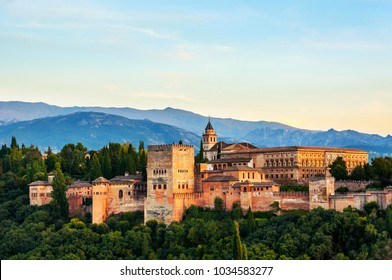Granada, Spain. Aerial view of Alhambra Palace in Granada, Spain with Sierra Nevada mountains at the background. Sunset sky