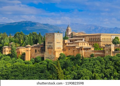 Granada, Spain. Aerial view of Alhambra Palace in Granada, Spain with Sierra Nevada mountains at the background.