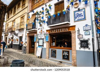 Granada, Spain, April 06, 2018: Street view of the historic district of Albaicin in Granada, Andalusia, Spain