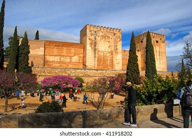GRANADA, SPAIN - APRIL 11, 2106: Tourists visiting Alhambra, Granada, Spain. Walls of Alcazaba fortress can be seen.