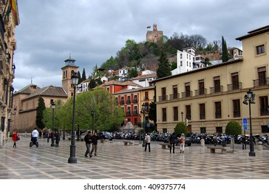 GRANADA, SPAIN - April 12, 2016: Plaza Nueva with a view of the Alhambra on the hill
