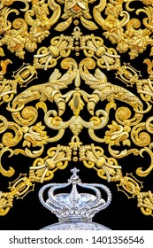 Granada, Spain - April 12,2019: A beautiful detail of an ancient gold embroidery work on 16th century Spanish dalmatic vestment.