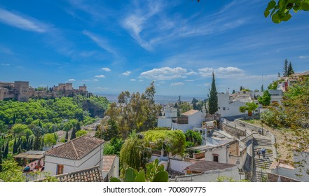 Granada, Spain, April 26, 2014 - View of Alhambra with Gypsy Cave Sacromonte in Granada, Andalucia, Spain