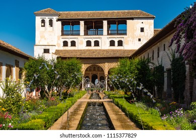 Granada, SPAIN - Aug, 2017: Beautiful pools and exteriors of the Alhambra.