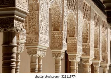 GRANADA, SPAIN- AUGUST 26, 2014: Arches in Islamic (Moorish)  style in Alhambra, Granada, Spain