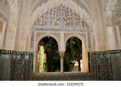 GRANADA, SPAIN- AUGUST 26, 2014:Arches in Islamic (Moorish)  style in Alhambra, Granada, Spain