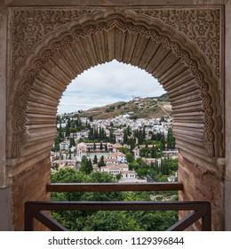 GRANADA, SPAIN - CIRCA JUNE, 2018: Alhambra Palace window detail, UNESCO site in Granada, Andalucia.