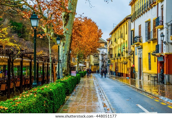 GRANADA, SPAIN, JANUARY 3, 2016: View of a street with bars and restaurants situated on riverside of river darro in spanish city granada