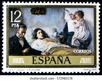 GRANADA, SPAIN - January 31, 2017: stamp printed in Spain shows Science and Charity by Pablo Ruiz Picasso, 1978