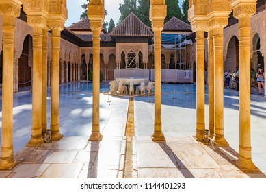 GRANADA, SPAIN - JULY 11, 2016: Patio de los Leones (Court of the Lions) of the Nasrid dynasty Palace of the Lions in the Alhambra, Granada, Andalusia, Spain.