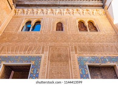 GRANADA, SPAIN - JULY 11, 2016: Facade of the Palacio de Comares (Comares Palace) in the Alhambra, Granada, Andalusia, Spain.