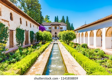 GRANADA, SPAIN -  JULY 12, 2016: Patio de la Acequia (Water Garden Courtyard) of the Generalife  at the  Royal complex of Alhambra, Granada, Andalusia, Spain.