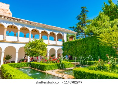 GRANADA, SPAIN -  JULY 12, 2016: Patio del Cipres de la Sultana (Court of the Sultana's Cypress Tree) of the Generalife at the  Royal complex of Alhambra, Granada, Andalusia, Spain.