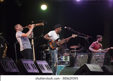 GRANADA, SPAIN - JULY 23, 2015: Marcus Miller and his band, Afrodeezia tour, at 28 International Jazz Festival of Almunecar, Spain. A. Agati, A. Hans and Marcus Miller.
