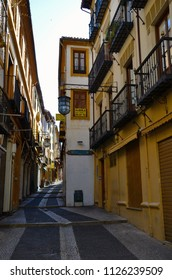 Granada, Spain - July 8th 2014: Beautiful streets in spanish Granada. Granada is popular with the tourist mainly because of Alhambra and Albaicin district both representing old Moorish architecture.