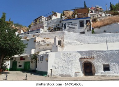 Granada, Spain - July 9, 2019: View of traditional caves in Sacromonte neighbourhood, gypsy district well-known for flamenco dance