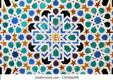 Granada, Spain - Jun 13, 2015: Background of arab tiles, islamic mosaic. Palace of Alhambra in Granada, Andalusia, Spain