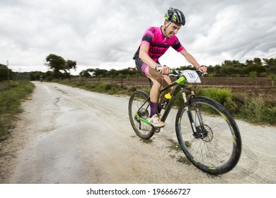 "GRANADA, SPAIN - JUNE 1: Unknown racer on the competition of the mountain bike ""La Mamut Padul Bike"" on June 1, 2014 in Granada, Spain"