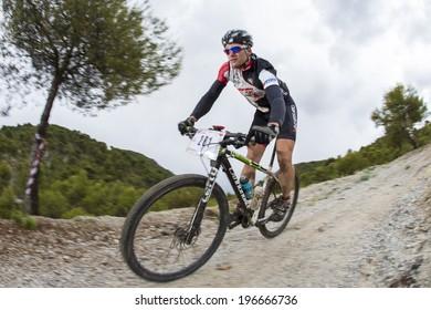"GRANADA, SPAIN - JUNE 1: Unknown racer on the competition of the mountain bike ""La Mamut Padul Bike"" on June 1, 2014 in Granada, Spain"