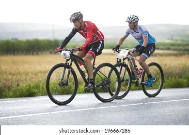 """GRANADA, SPAIN - JUNE 1: Unknowns racers on the competition of the mountain bike """"La Mamut Padul Bike"""" on June 1, 2014 in Granada, Spain"""