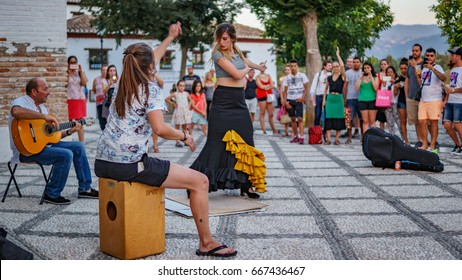 GRANADA, SPAIN - JUNE 23: Unidentified flamenco dancer dances for tourists in St. Nicolas viewpoint to Alhambra in Granada on June 23, 2017 in Spain