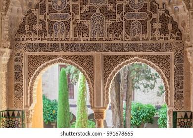 GRANADA, SPAIN - JUNE 26, 2016: Windows of Mexuar Hall at Nasrid Palaces, Alhambra, Granada, Spain
