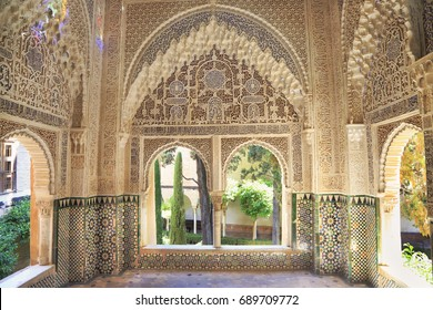 GRANADA, SPAIN - JUNE 28, 2017: Moorish architecture of the Nasrin Palace, The Alhambra, Granada, Andalusia, Spain, Europe.