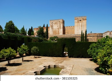 GRANADA, SPAIN - JUNE 4, 2008 - Cistern court featuring castle towers with an ornamental pool in the foreground, Palace of Alhambra, Granada, Granada Province, Andalusia, Spain, June 4, 2008.