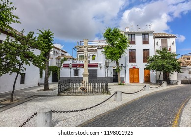 GRANADA, SPAIN - JUNE 5, 2018: Granada Plaza san Miguel Bajo - rectangular plaza with outdoor restaurants offering typical Spanish food and San Miguel Bajo Church (Iglesia de San Miguel Bajo).