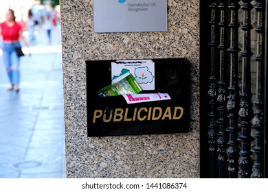 Granada / Spain - June 9 2019: A publicidad mailbox for delivering advertisement and publicity flyers on  wall outside an office building in Spain.