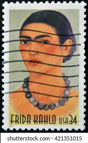 GRANADA, SPAIN  - MARCH 11, 2012: stamp printed in USA show great Mexican painter Frida Kahlo, circa 2001