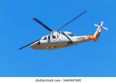 Granada, Spain - May 11th, 2019: helicopter with a spanish flag during an air show