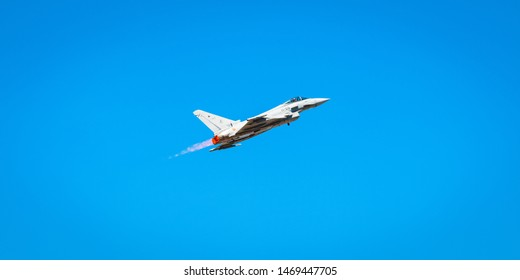 Granada, Spain - May 11th, 2019: Eurofighter Typhoon military jet during an air show with the afterburners on