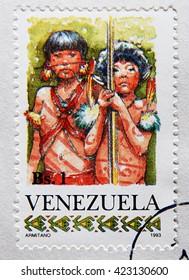 GRANADA, SPAIN - MAY 15, 2016: Stamp printed in Venezuela shows Two Yanomami Children, circa 1993
