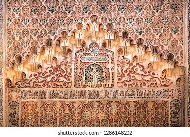 GRANADA, SPAIN - NOV 21: Ceramic relief inside 14th century Madraza de Granada, example of historical arabic architecture on November 21, 2018. Population of Granada is near 250,000